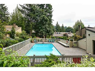 "Photo 1: 1037 HERITAGE Boulevard in North Vancouver: Seymour NV Townhouse for sale in ""HERITAGE IN THE WOODS"" : MLS®# V1090687"