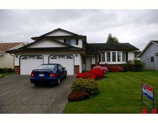 """Photo 1: 6884 COACH LAMP Drive in Sardis: Sardis West Vedder Rd House for sale in """"WELLS LANDING"""" : MLS®# H2901855"""