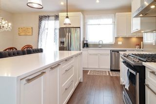 """Photo 9: 82 7665 209 Street in Langley: Willoughby Heights Townhouse for sale in """"Archstone"""" : MLS®# R2594119"""