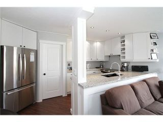 "Photo 5: # 213 2010 W 8TH AV in Vancouver: Kitsilano Condo for sale in ""AUGUSTINE GARDENS"" (Vancouver West)  : MLS®# V880530"