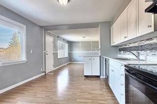 Photo 8: 7943 48 Avenue NW in Calgary: Bowness Detached for sale : MLS®# A1096332
