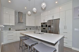 Photo 5: 154 21 Avenue NW in Calgary: Tuxedo Park Row/Townhouse for sale : MLS®# A1098746