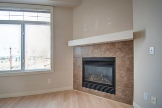 Photo 7: 304 132 1 Avenue NW: Airdrie Apartment for sale : MLS®# A1091993