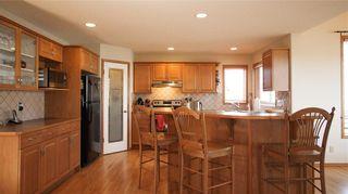 Photo 5: 208 WEST TERRACE Place: Cochrane House for sale : MLS®# C4192643