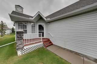 Photo 2: 38 1008 Woodside Way NW: Airdrie Row/Townhouse for sale : MLS®# A1123458