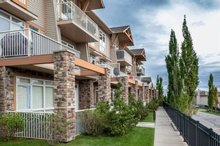 Photo 4: 9 140 Rockyledge View NW in Calgary: Rocky Ridge Row/Townhouse for sale : MLS®# A1118889