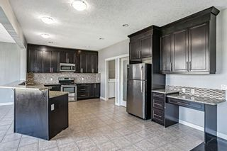 Photo 13: 121 Kinniburgh Boulevard: Chestermere Detached for sale : MLS®# A1147632