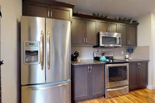 Photo 15: 120 Cy Becker BLVD in Edmonton: House Half Duplex for sale : MLS®# E4182256