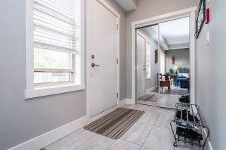 "Photo 13: 104 2110 ROWLAND Street in Port Coquitlam: Central Pt Coquitlam Townhouse for sale in ""AVIVA ON THE PARK"" : MLS®# R2168071"