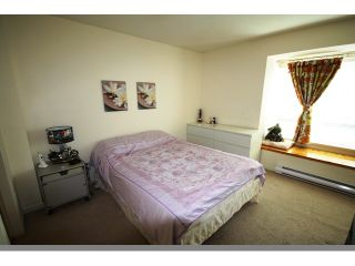 """Photo 7: 102 6588 SOUTHOAKS Crescent in Burnaby: Highgate Townhouse for sale in """"TUDOR GROVE SOUTH"""" (Burnaby South)  : MLS®# V829465"""