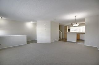 Photo 6: 25 Tuscany Springs Gardens NW in Calgary: Tuscany Row/Townhouse for sale : MLS®# A1053153