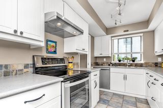 """Photo 13: 105 1379 MERKLIN Street: White Rock Condo for sale in """"THE ROSEWOOD"""" (South Surrey White Rock)  : MLS®# R2590545"""