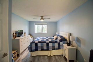 Photo 12: 209 2022 CANYON MEADOWS Drive SE in Calgary: Queensland Apartment for sale : MLS®# A1028544
