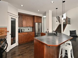 Photo 16: 45 Crestbrook Hill SW in Calgary: Crestmont Detached for sale : MLS®# A1141803