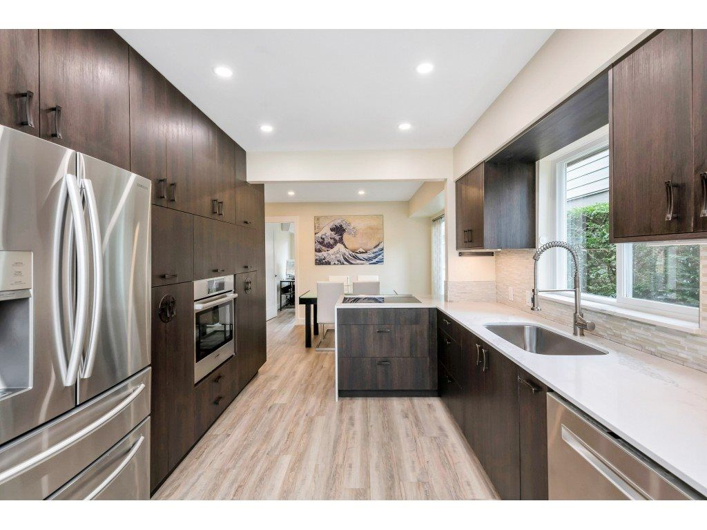 """Main Photo: 9518 WILLOWLEAF Place in Burnaby: Forest Hills BN Townhouse for sale in """"Willowleaf Place"""" (Burnaby North)  : MLS®# R2561728"""