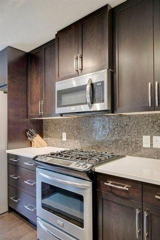 Photo 11: 35 ASPEN HILLS Green SW in Calgary: Aspen Woods Row/Townhouse for sale : MLS®# A1033284