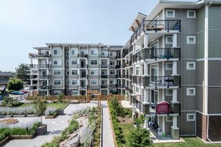 """Photo 5: 406 20696 EASTLEIGH Crescent in Langley: Langley City Condo for sale in """"The Georgia"""" : MLS®# R2621098"""