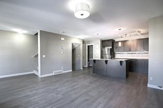 Photo 8: 555 Redstone View NE in Calgary: Redstone Row/Townhouse for sale : MLS®# A1149779