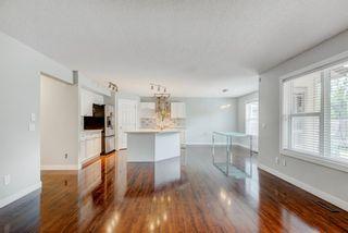 Photo 5: 572 Cougar Ridge Drive SW in Calgary: Cougar Ridge Detached for sale : MLS®# A1143842
