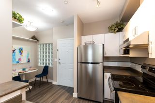 """Photo 6: 418 20200 56 Avenue in Langley: Langley City Condo for sale in """"The Bentley"""" : MLS®# R2612612"""