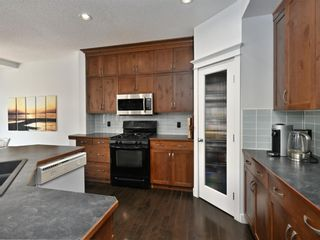 Photo 15: 45 Crestbrook Hill SW in Calgary: Crestmont Detached for sale : MLS®# A1141803