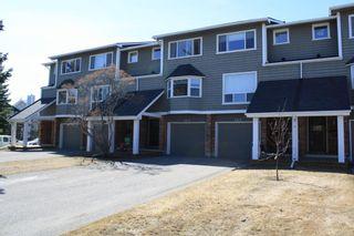 Photo 2: 155 Woodglen Grove SW in Calgary: Woodbine Row/Townhouse for sale : MLS®# A1111789