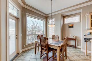 Photo 12: 227 Sunterra Ridge Place: Cochrane Detached for sale : MLS®# A1058667