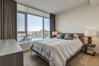 Photo 32: 501 128 Waterfront Court SW in Calgary: Chinatown Apartment for sale : MLS®# A1107113
