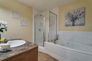 Photo 18: 17 11 Scarpe Drive SW in Calgary: Garrison Woods Row/Townhouse for sale : MLS®# A1103969