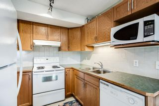 Photo 10: 401 300 Edwards Way NW: Airdrie Apartment for sale : MLS®# A1111826