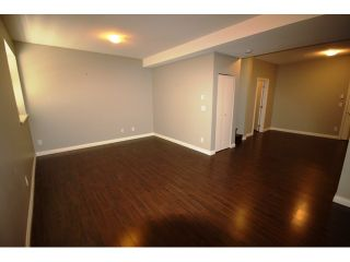 """Photo 6: 104 6878 SOUTHPOINT Drive in Burnaby: South Slope Townhouse for sale in """"CORTINA"""" (Burnaby South)  : MLS®# V878295"""
