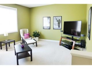 Photo 19: 772 LUXSTONE Landing SW: Airdrie House for sale : MLS®# C4016201