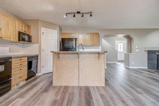 Photo 10: 52 COUGARSTONE Villa SW in Calgary: Cougar Ridge Detached for sale : MLS®# A1020063
