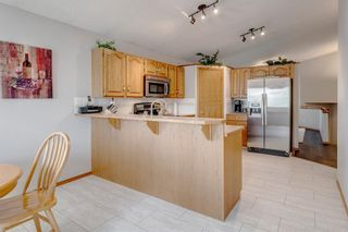 Photo 18: 60 Woodside Crescent NW: Airdrie Detached for sale : MLS®# A1110832