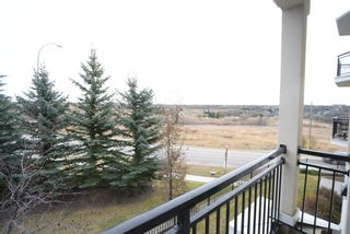 Photo 3: 204 26 VAL GARDENA View SW in Calgary: Springbank Hill Apartment for sale : MLS®# A1045498
