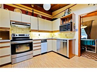 Photo 8: 3527 LAKESIDE Crescent SW in Calgary: Lakeview House for sale : MLS®# C4035307