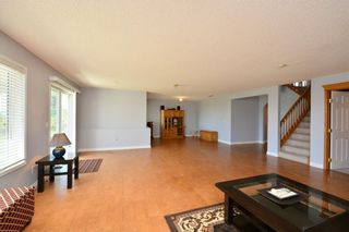 Photo 38: 303 GLENEAGLES View: Cochrane House for sale : MLS®# C4130061