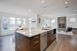 Photo 4: 127 Springbluff Boulevard SW in Calgary: Springbank Hill Detached for sale : MLS®# A1140601