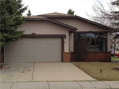 Main Photo: 4 WOODBROOK Way SW in Calgary: Bungalow for sale : MLS®# C3517374