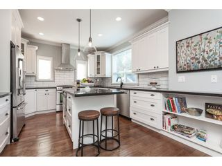 """Photo 11: 7089 179 Street in Surrey: Cloverdale BC House for sale in """"Provinceton"""" (Cloverdale)  : MLS®# R2492815"""