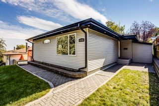 Main Photo: 12256 Canfield Road SW in Calgary: Canyon Meadows Detached for sale : MLS®# A1149444