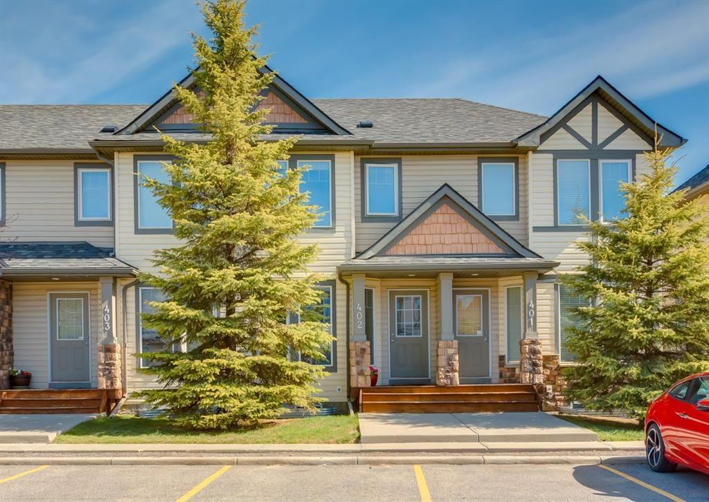 Main Photo: 402 2445 Kingsland Road SE: Airdrie Row/Townhouse for sale : MLS®# A1107683