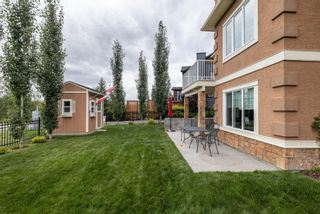 Photo 43: Spacious and Beautiful Valley Ridge Home backing out on to the Ravine