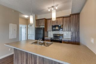 Photo 9: 9308 101 Sunset Drive: Cochrane Apartment for sale : MLS®# A1079009