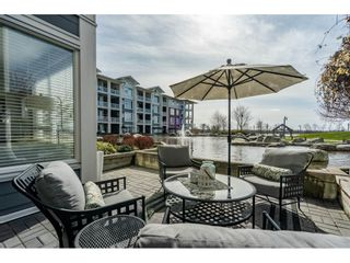 "Photo 1: 103 4500 WESTWATER Drive in Richmond: Steveston South Condo for sale in ""COPPER SKY WEST"" : MLS®# R2447932"