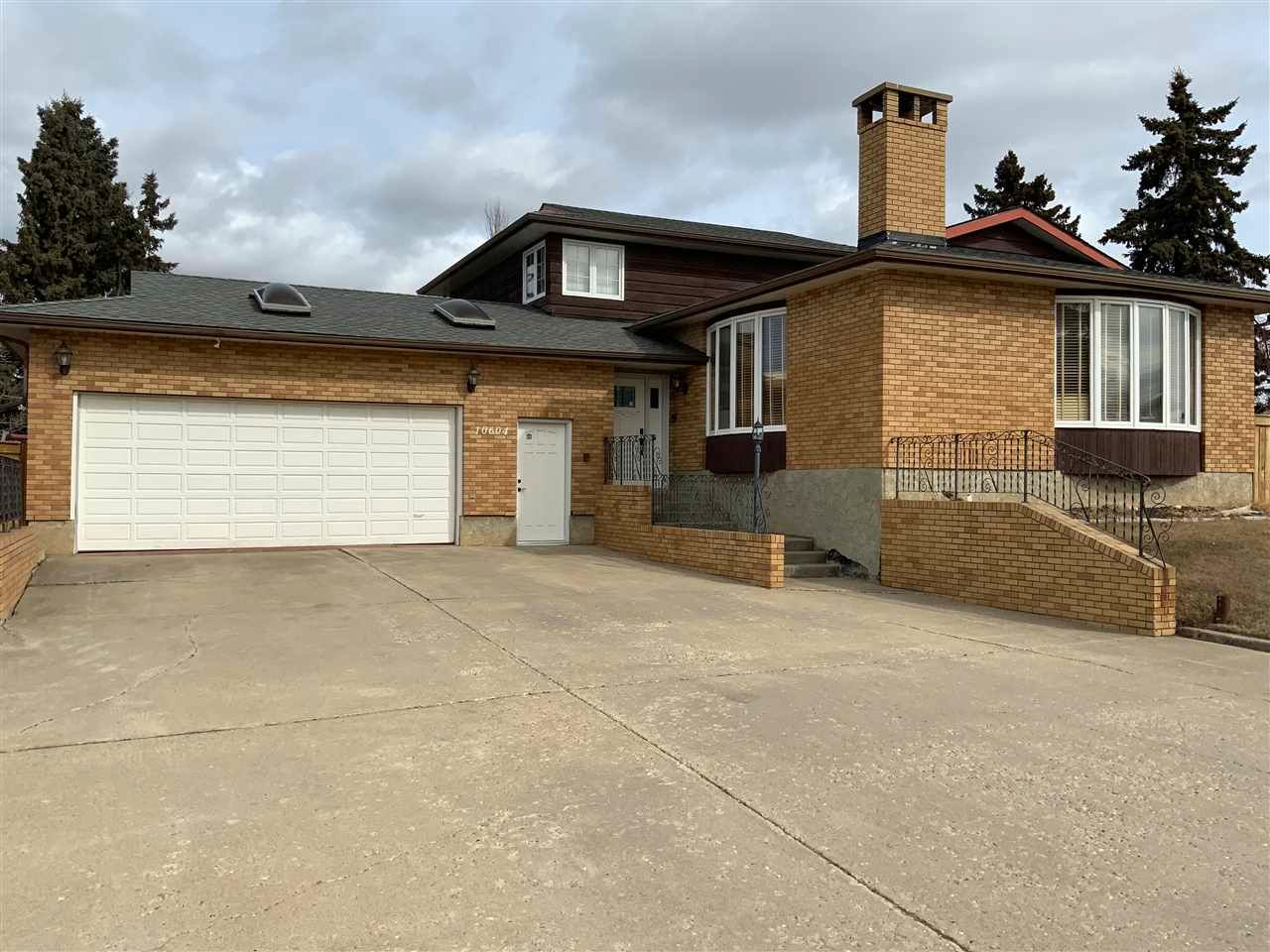 Big double car garage and RV parking with concrete driveway.