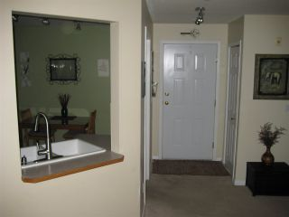 """Photo 1: 201 12088 66 Avenue in Surrey: West Newton Condo for sale in """"LAKEWOOD TERRACE"""" : MLS®# R2588884"""