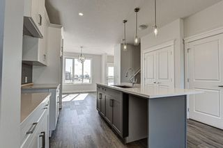 Photo 11: 136 Creekside Drive SW in Calgary: C-168 Semi Detached for sale : MLS®# A1108851