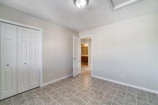 Photo 26: 4 136 Bow Ridge Drive: Cochrane Row/Townhouse for sale : MLS®# A1116097