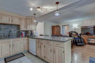 Photo 16: 7 Strandell Crescent SW in Calgary: Strathcona Park Detached for sale : MLS®# A1150531